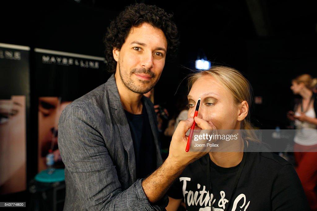 Andre Maertens and a model are seen backstage ahead of the Dimitri show during the Mercedes-Benz Fashion Week Berlin Spring/Summer 2017 at Erika Hess Eisstadion on June 30, 2016 in Berlin, Germany.