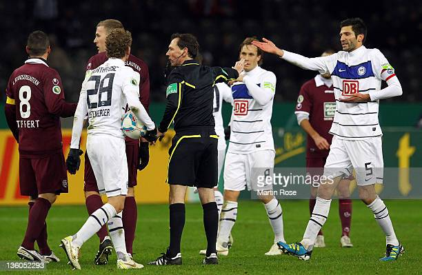 Andre Mijatovic of Berlin argues with referee Florian Meyer during the DFB Cup round of sixteen match between Hertha BSC Berlin and 1 FC...