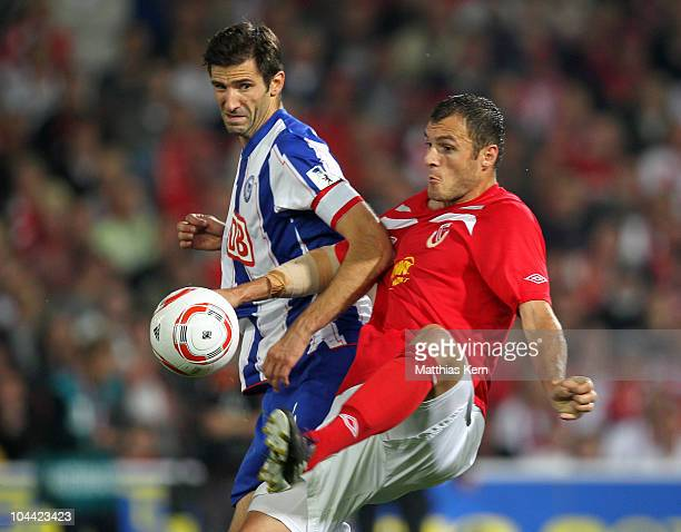 Andre Mijatovic of Berlin battles for the ball with Emil Jula of Cottbus during the Second Bundesliga match between FC Energie Cottbus and Hertha BSC...