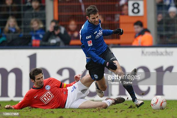 Andre Mijatovic of Berlin tackles Josip Tadic of Bielefeld during the Second Bundesliga match between Arminia Bielefeld and Hertha BSC Berlin at the...