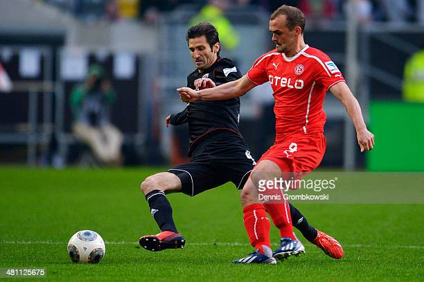 Andre Mijatovic of FC Ingolstadt is challenged by Erwin Hoffer of Fortuna Duesseldorf during the Second Bundesliga match between Fortuna Duesseldorf...