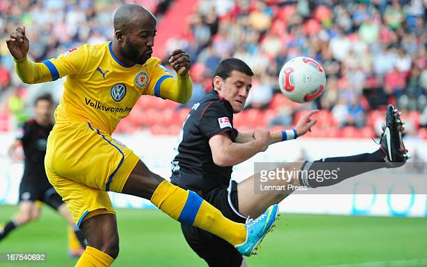 Andre Mijatovic of Ingolstadt challenges Dominik Kumbela of Braunschweig during the 2 Bundesliga match between FC Ingolstadt and Eintracht...