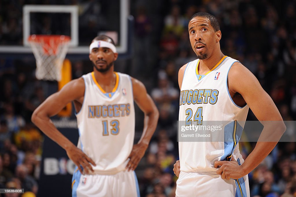 Andre Miller #24 and Corey Brewer #13 of the Denver Nuggets wait to resume action against the Memphis Grizzlies on December 14, 2012 at the Pepsi Center in Denver, Colorado.