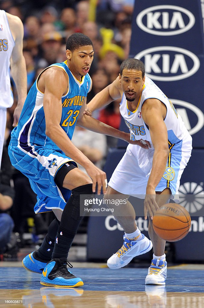 Andre Miller of Denver Nuggets #24 steals the ball from Anthony Davis of New Orleans Hornets #23 in the 2nd half of the game on February 1, 2013 at Pepsi Center in Denver, Colorado. Denver won 113-98.