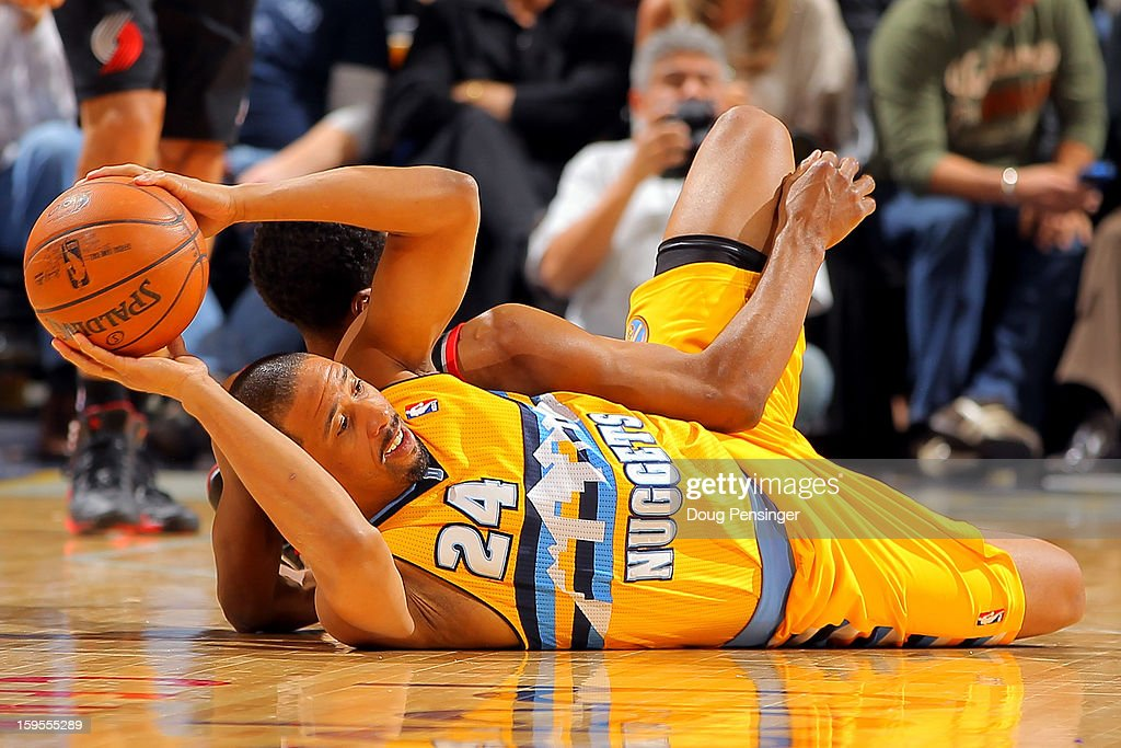 Andre Miller #24 of the Denver Nuggets and Ronnie Price #24 of the Portland Trail Blazers battle for a loose ball at the Pepsi Center on January 15, 2013 in Denver, Colorado. The Nuggets defeated the Trail Blazers 115-111 in overtime.