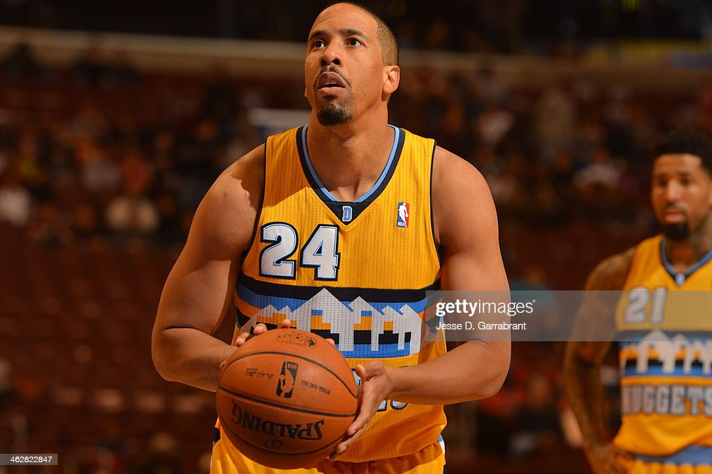 <a gi-track='captionPersonalityLinkClicked' href=/galleries/search?phrase=Andre+Miller&family=editorial&specificpeople=201678 ng-click='$event.stopPropagation()'>Andre Miller</a> #24 of the Denver Nuggets attempts a foul shot against the Philadelphia 76ers at the Wells Fargo Center on December 7, 2013 in Philadelphia, Pennsylvania.
