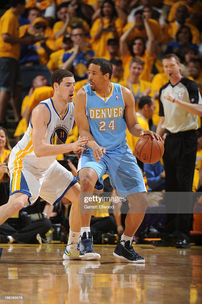 <a gi-track='captionPersonalityLinkClicked' href=/galleries/search?phrase=Andre+Miller&family=editorial&specificpeople=201678 ng-click='$event.stopPropagation()'>Andre Miller</a> #24 of the Denver Nuggets controls the ball against <a gi-track='captionPersonalityLinkClicked' href=/galleries/search?phrase=Klay+Thompson&family=editorial&specificpeople=5132325 ng-click='$event.stopPropagation()'>Klay Thompson</a> #11 of the Golden State Warriors in Game Four of the Western Conference Quarterfinals during the 2013 NBA Playoffs on April 28, 2013 at the Oracle Arena in Oakland, California.