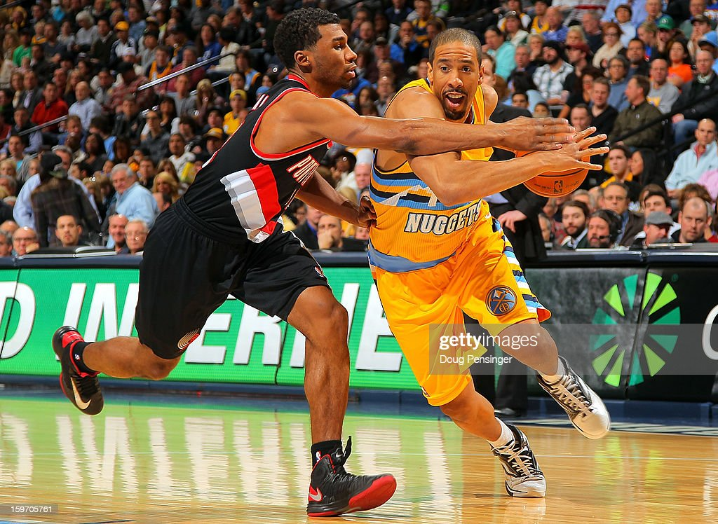 <a gi-track='captionPersonalityLinkClicked' href=/galleries/search?phrase=Andre+Miller&family=editorial&specificpeople=201678 ng-click='$event.stopPropagation()'>Andre Miller</a> #24 of the Denver Nuggets controls the ball against <a gi-track='captionPersonalityLinkClicked' href=/galleries/search?phrase=Ronnie+Price&family=editorial&specificpeople=654750 ng-click='$event.stopPropagation()'>Ronnie Price</a> #24 of the Portland Trail Blazers at the Pepsi Center on January 15, 2013 in Denver, Colorado. The Nuggets defeated the Trail Blazers 115-111 in overtime.