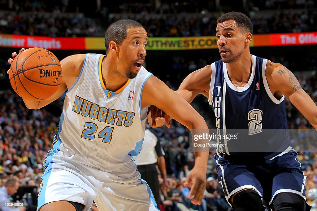 Andre Miller #24 of the Denver Nuggets controls the ball against Thabo Sefolosha #2 of the Oklahoma City Thunder at the Pepsi Center on March 1, 2013 in Denver, Colorado. The Nuggets defeated the Thunder 105-103.