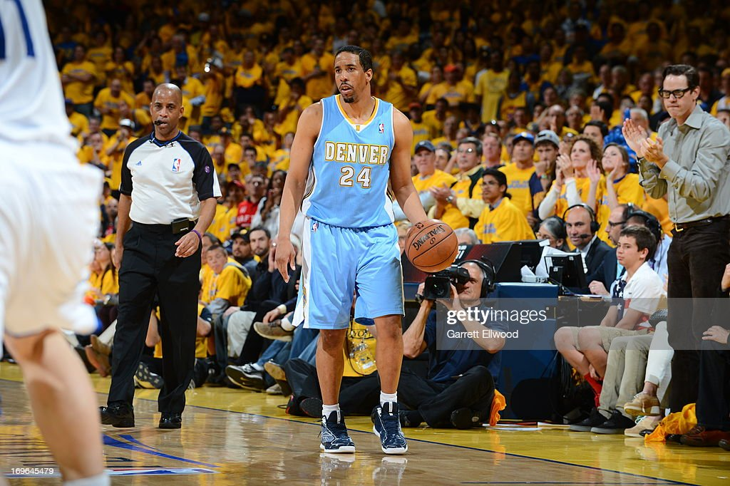 <a gi-track='captionPersonalityLinkClicked' href=/galleries/search?phrase=Andre+Miller&family=editorial&specificpeople=201678 ng-click='$event.stopPropagation()'>Andre Miller</a> #24 of the Denver Nuggets controls the ball against the Golden State Warriors in Game Three of the Western Conference Quarterfinals during the 2013 NBA Playoffs on April 26, 2013 at the Oracle Arena in Oakland, California.