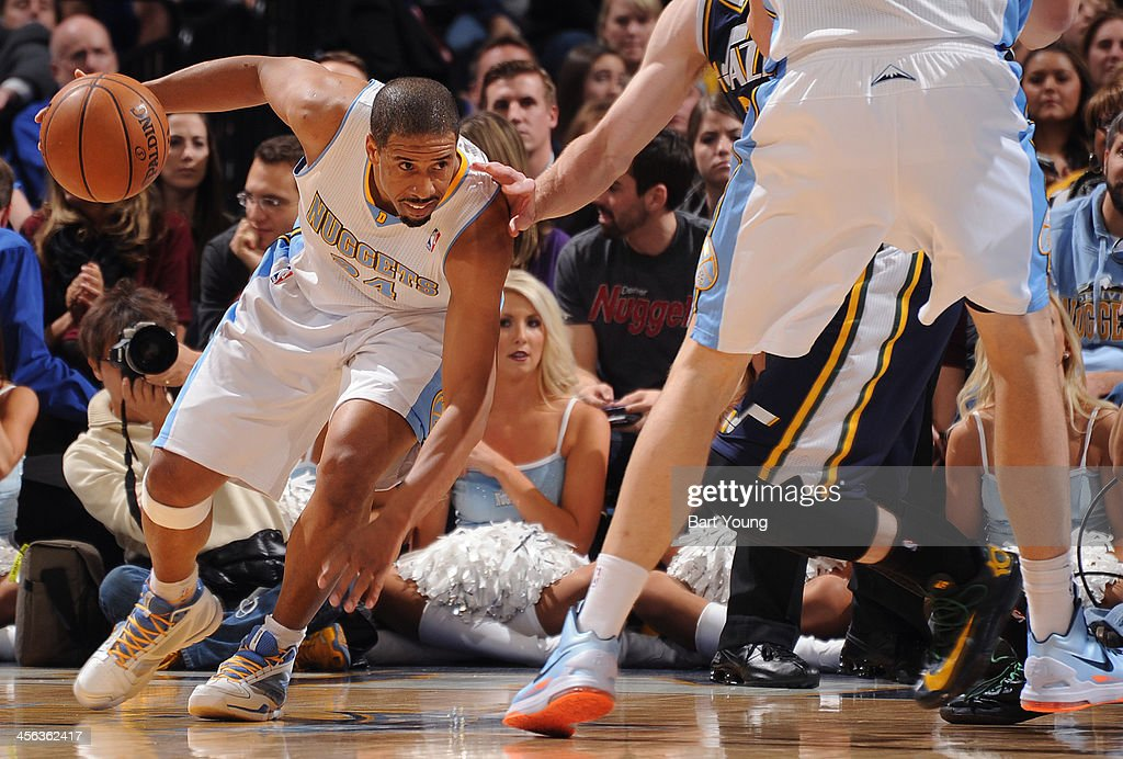 Andre Miller #24 of the Denver Nuggets dribbles the ball against the Utah Jazz on December 13, 2013 at the Pepsi Center in Denver, Colorado.