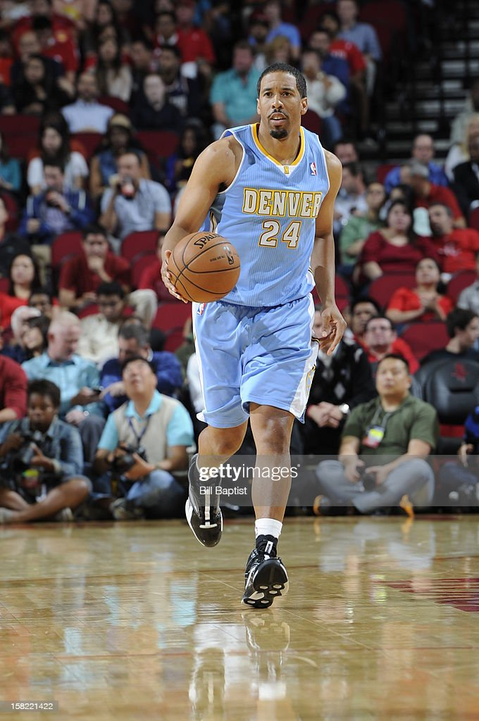 <a gi-track='captionPersonalityLinkClicked' href=/galleries/search?phrase=Andre+Miller&family=editorial&specificpeople=201678 ng-click='$event.stopPropagation()'>Andre Miller</a> #24 of the Denver Nuggets dribbles the ball up court against the Houston Rockets on November 7, 2012 at the Toyota Center in Houston, Texas.