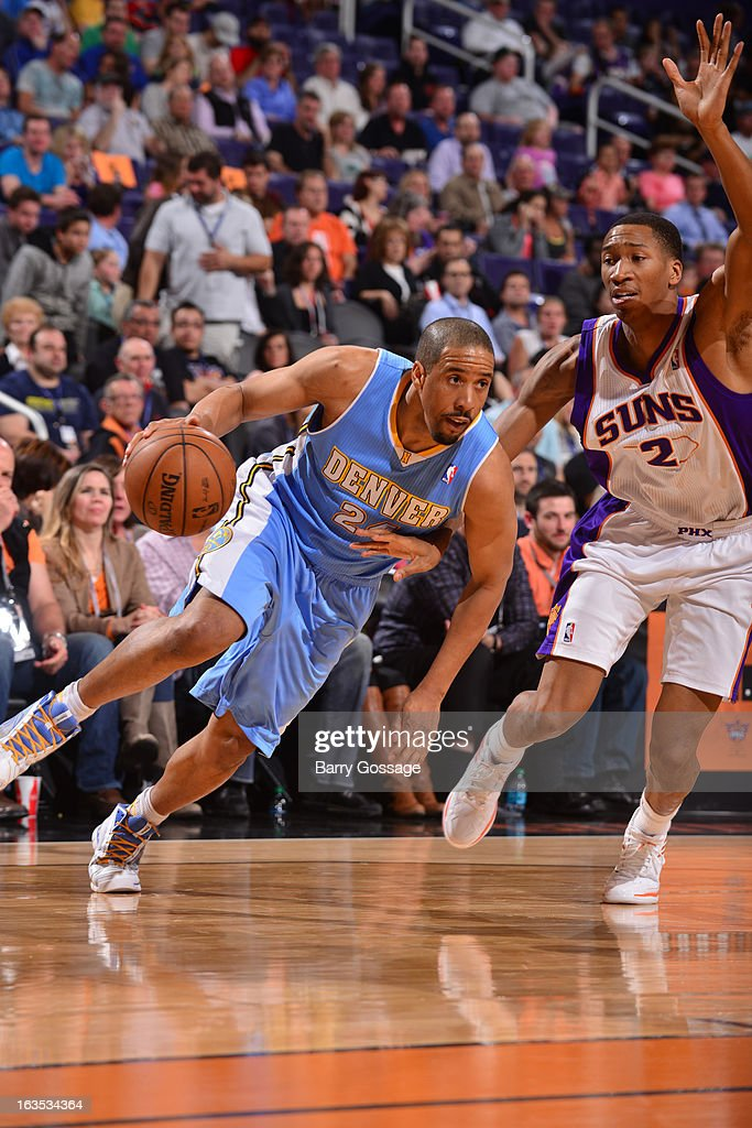 <a gi-track='captionPersonalityLinkClicked' href=/galleries/search?phrase=Andre+Miller&family=editorial&specificpeople=201678 ng-click='$event.stopPropagation()'>Andre Miller</a> #24 of the Denver Nuggets drives against <a gi-track='captionPersonalityLinkClicked' href=/galleries/search?phrase=Wesley+Johnson+-+Basketball+Player&family=editorial&specificpeople=4184049 ng-click='$event.stopPropagation()'>Wesley Johnson</a> #2 of the Phoenix Suns on March 11, 2013 at U.S. Airways Center in Phoenix, Arizona.