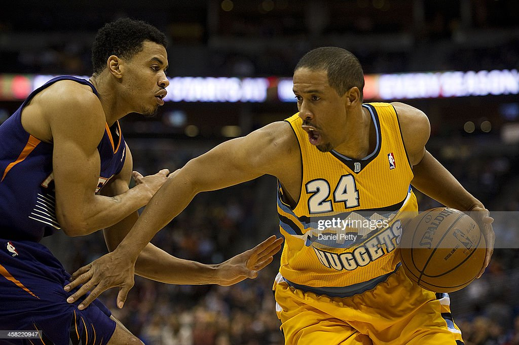 Andre Miller #24 of the Denver Nuggets drives around Gerald Green #14 of the Phoenix Suns during the second quarter of an NBA game at the Pepsi Center on December 20, 2013, in Denver, Colorado.
