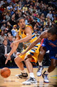 Andre Miller of the Denver Nuggets drives to the basket against Kim English of the Detroit Pistons on November 6 2012 at the Pepsi Center in Denver...