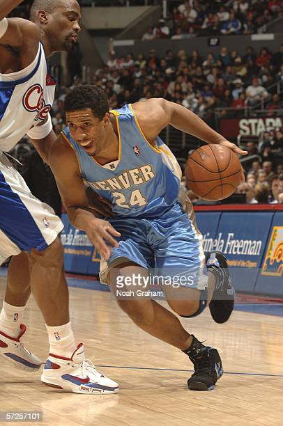 Andre Miller of the Denver Nuggets drives to the basket against Cuttino Mobley of the Los Angeles Clippers April 4 2006 at Staples Center in Los...