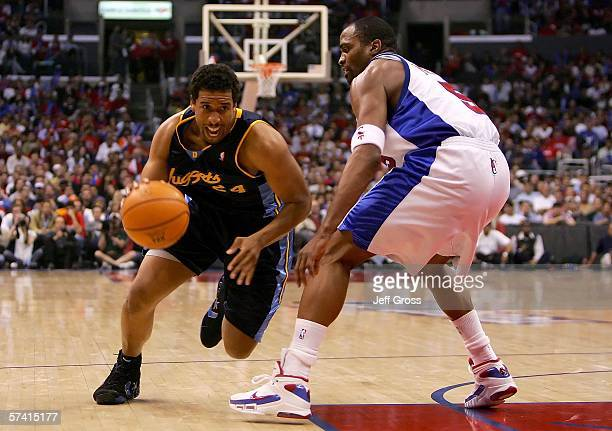 Andre Miller of the Denver Nuggets drives to the basket against Cuttino Mobley of the Los Angeles Clippers in game two of the Western Conference...
