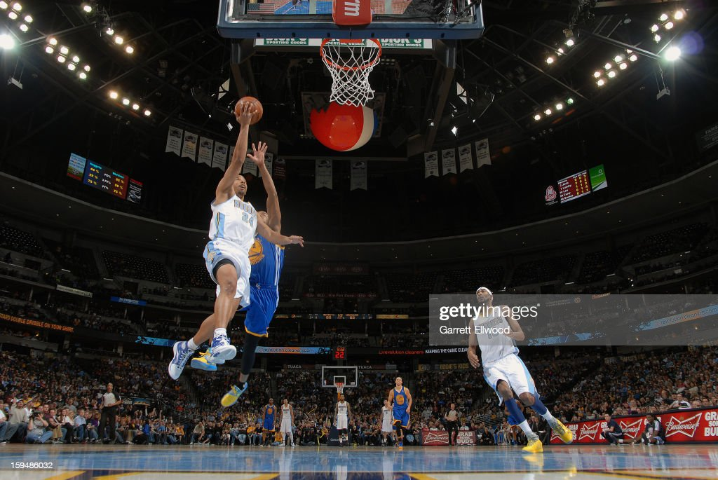 Andre Miller #24 of the Denver Nuggets drives to the basket against the Golden State Warriors on January 13, 2013 at the Pepsi Center in Denver, Colorado.