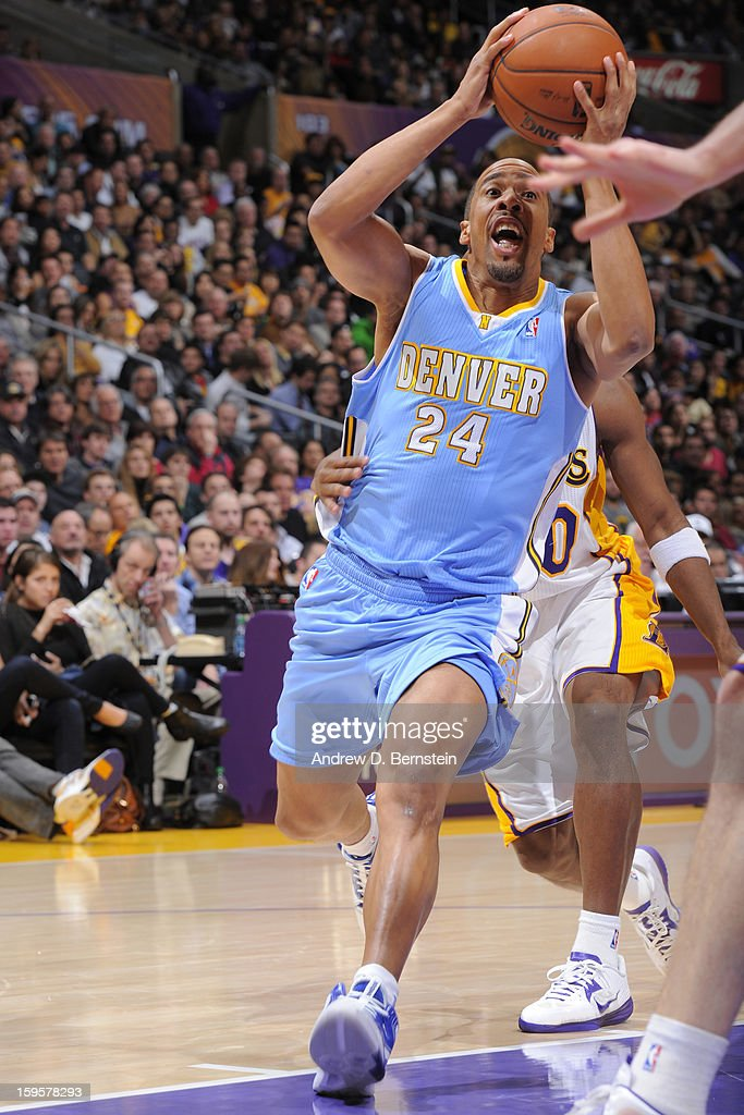 <a gi-track='captionPersonalityLinkClicked' href=/galleries/search?phrase=Andre+Miller&family=editorial&specificpeople=201678 ng-click='$event.stopPropagation()'>Andre Miller</a> #24 of the Denver Nuggets drives to the basket against the Los Angeles Lakers at Staples Center on January 6, 2013 in Los Angeles, California.