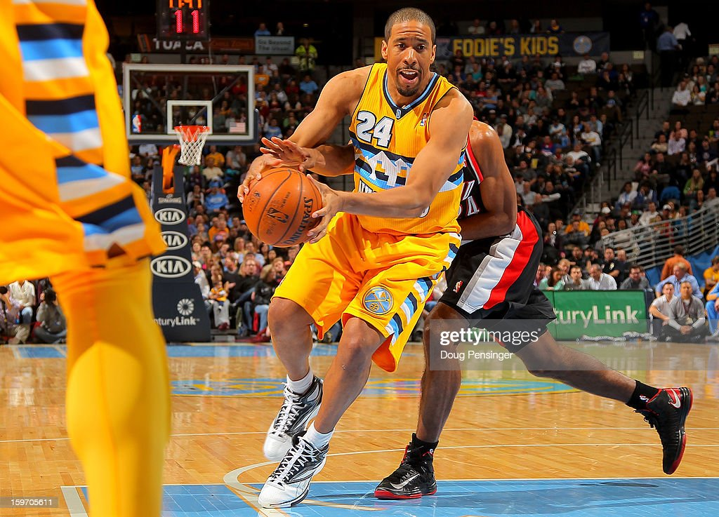 <a gi-track='captionPersonalityLinkClicked' href=/galleries/search?phrase=Andre+Miller&family=editorial&specificpeople=201678 ng-click='$event.stopPropagation()'>Andre Miller</a> #24 of the Denver Nuggets drives to the basket against the Portland Trail Blazers at the Pepsi Center on January 15, 2013 in Denver, Colorado. The Nuggets defeated the Trail Blazers 115-111 in overtime.