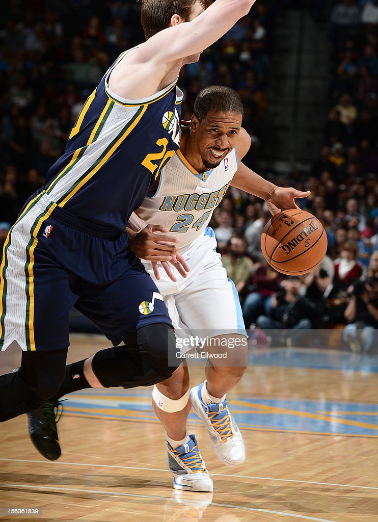 Andre Miller #24 of the Denver Nuggets drives to the basket against the Utah Jazz on December 13, 2013 at the Pepsi Center in Denver, Colorado.