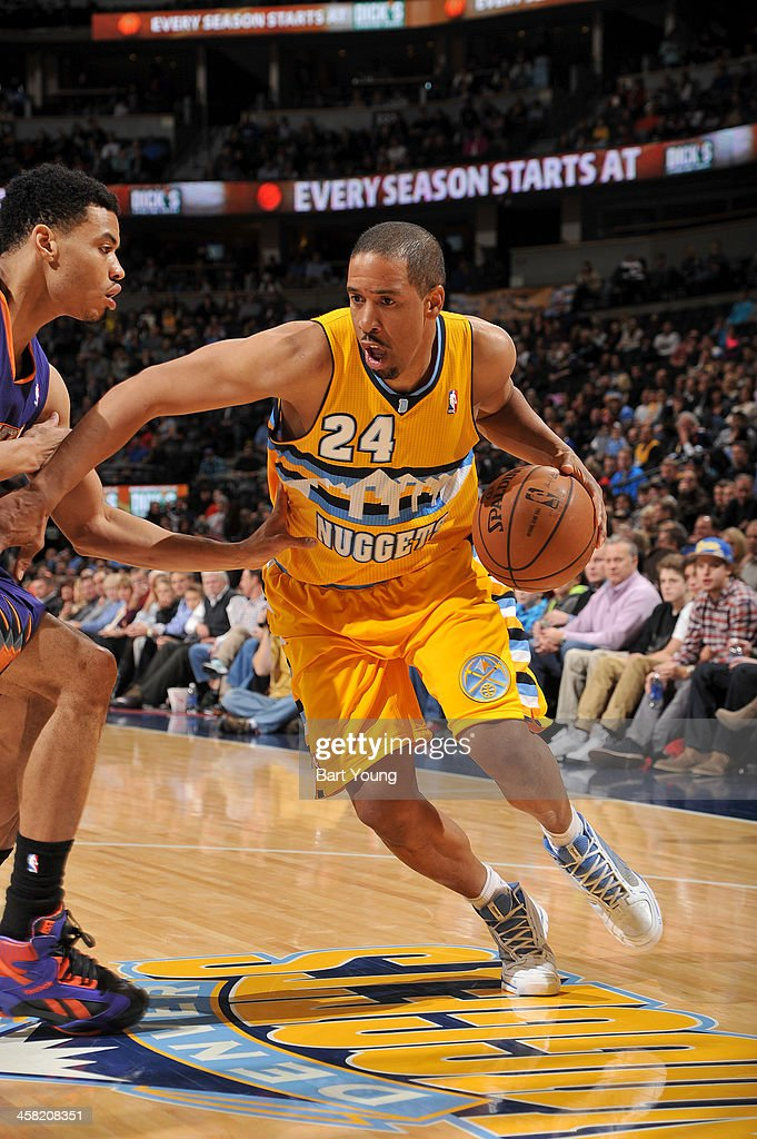 Andre Miller #24 of the Denver Nuggets drives to the basket against the Phoenix Suns on December 20, 2013 at the Pepsi Center in Denver, Colorado.