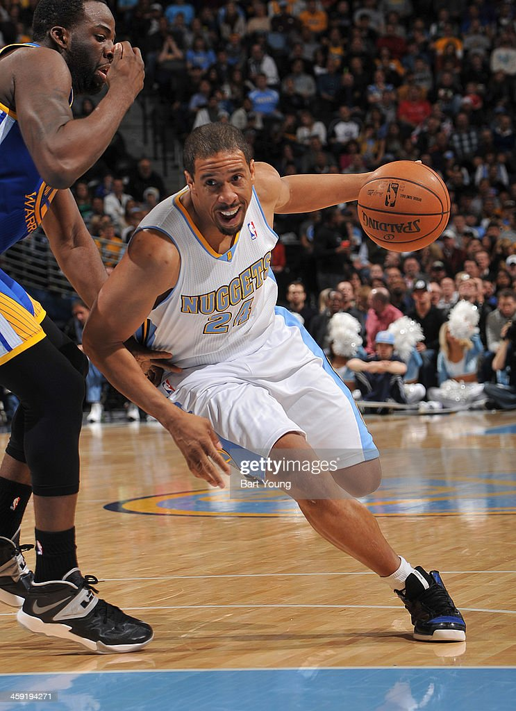 <a gi-track='captionPersonalityLinkClicked' href=/galleries/search?phrase=Andre+Miller&family=editorial&specificpeople=201678 ng-click='$event.stopPropagation()'>Andre Miller</a> #24 of the Denver Nuggets drives to the basket against the Golden State Warriors on December 23, 2013 at the Pepsi Center in Denver, Colorado.