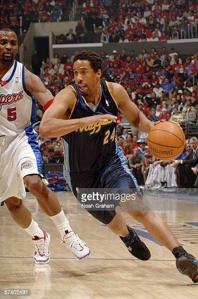 Andre Miller of the Denver Nuggets drives to the hoop against Cuttino Mobley of the Los Angeles Clippers in game one of the Western Conference...