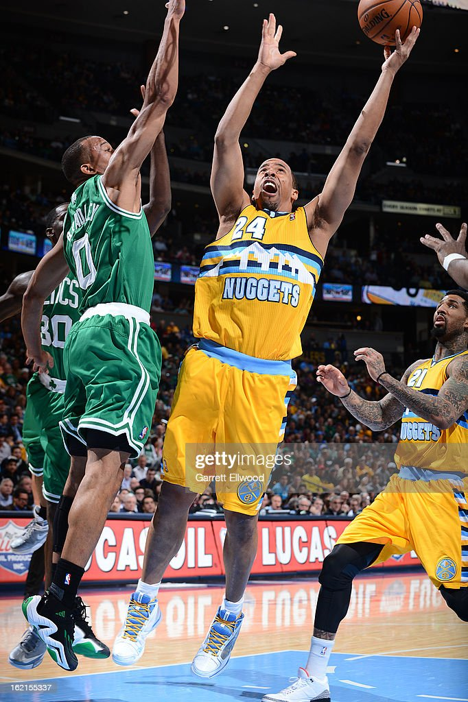 Andre Miller #24 of the Denver Nuggets goes up for the layup against Avery Bradley #0 of the Boston Celtics versus the Denver Nuggets on February 19, 2013 at the Pepsi Center in Denver, Colorado.