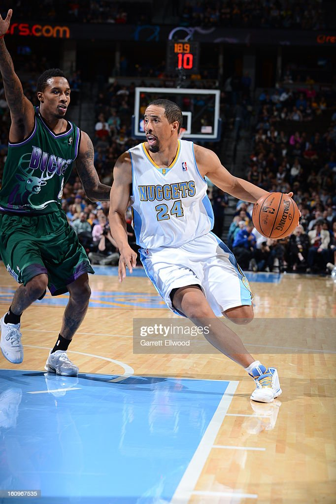 <a gi-track='captionPersonalityLinkClicked' href=/galleries/search?phrase=Andre+Miller&family=editorial&specificpeople=201678 ng-click='$event.stopPropagation()'>Andre Miller</a> #24 of the Denver Nuggets handles the ball against Brandon Jennings #3 of the Milwaukee Bucks on February 5, 2013 at the Pepsi Center in Denver, Colorado.