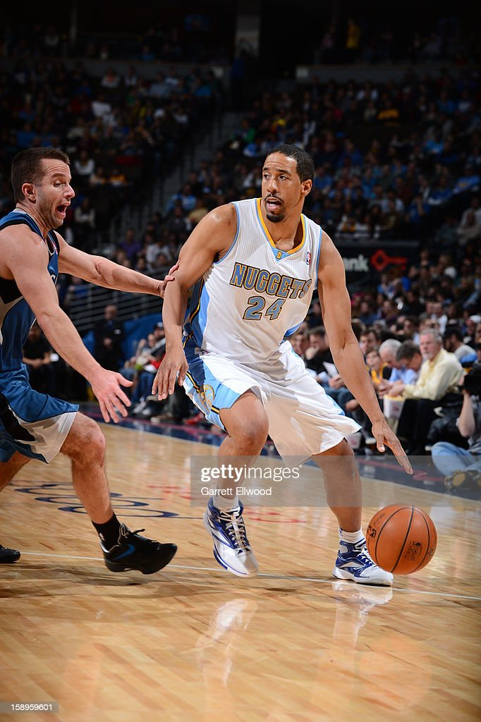 <a gi-track='captionPersonalityLinkClicked' href=/galleries/search?phrase=Andre+Miller&family=editorial&specificpeople=201678 ng-click='$event.stopPropagation()'>Andre Miller</a> #24 of the Denver Nuggets handles the ball against Jose Juan Barea #11 of the Minnesota Timberwolves on January 3, 2013 at the Pepsi Center in Denver, Colorado.