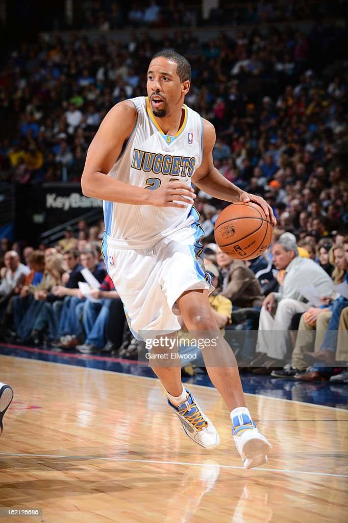 <a gi-track='captionPersonalityLinkClicked' href=/galleries/search?phrase=Andre+Miller&family=editorial&specificpeople=201678 ng-click='$event.stopPropagation()'>Andre Miller</a> #24 of the Denver Nuggets handles the ball against the Sacramento Kings on January 26, 2013 at the Pepsi Center in Denver, Colorado.
