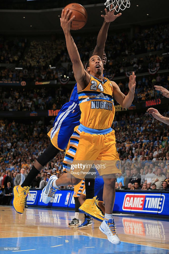 <a gi-track='captionPersonalityLinkClicked' href=/galleries/search?phrase=Andre+Miller&family=editorial&specificpeople=201678 ng-click='$event.stopPropagation()'>Andre Miller</a> #24 of the Denver Nuggets lays in the game winning shot against <a gi-track='captionPersonalityLinkClicked' href=/galleries/search?phrase=Draymond+Green&family=editorial&specificpeople=5628054 ng-click='$event.stopPropagation()'>Draymond Green</a> #23 of the Golden State Warriors with 1.2 seconds remaining in the game during Game One of the Western Conference Quarterfinals of the 2013 NBA Playoffs at the Pepsi Center on April 20, 2013 in Denver, Colorado. The Nuggets defeated the Warriors 97-95.