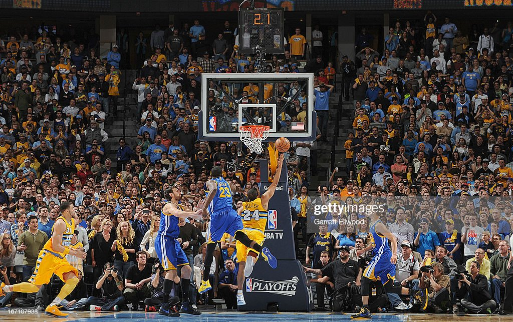 Andre Miller #24 of the Denver Nuggets makes the game winning shot as time expires in the fourth quarter against Draymond Green #23 of the Golden State Warriors in Game One of the Western Conference Quarterfinals during the 2013 NBA Playoffs on April 20, 2013 at the Pepsi Center in Denver, Colorado.