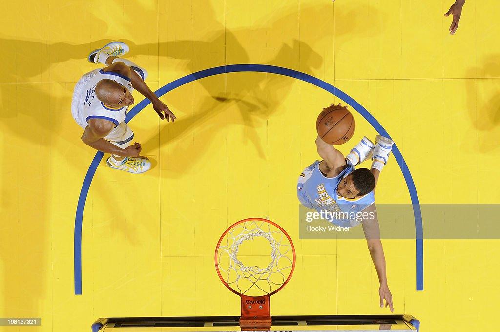 <a gi-track='captionPersonalityLinkClicked' href=/galleries/search?phrase=Andre+Miller&family=editorial&specificpeople=201678 ng-click='$event.stopPropagation()'>Andre Miller</a> #24 of the Denver Nuggets rebounds against the Golden State Warriors in Game Six of the Western Conference Quarterfinals during the 2013 NBA Playoffs on May 2, 2013 at Oracle Arena in Oakland, California.