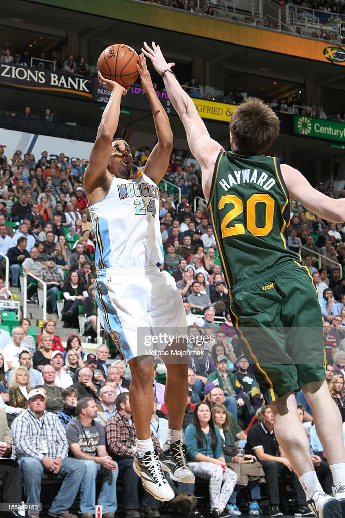 <a gi-track='captionPersonalityLinkClicked' href=/galleries/search?phrase=Andre+Miller&family=editorial&specificpeople=201678 ng-click='$event.stopPropagation()'>Andre Miller</a> #24 of the Denver Nuggets shoots against <a gi-track='captionPersonalityLinkClicked' href=/galleries/search?phrase=Gordon+Hayward&family=editorial&specificpeople=5767271 ng-click='$event.stopPropagation()'>Gordon Hayward</a> #20 of the Utah Jazz at Energy Solutions Arena on November 26, 2012 in Salt Lake City, Utah.