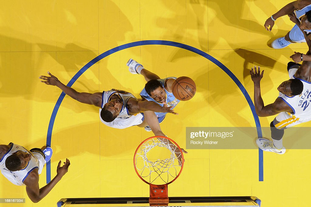 <a gi-track='captionPersonalityLinkClicked' href=/galleries/search?phrase=Andre+Miller&family=editorial&specificpeople=201678 ng-click='$event.stopPropagation()'>Andre Miller</a> #24 of the Denver Nuggets shoots against <a gi-track='captionPersonalityLinkClicked' href=/galleries/search?phrase=Harrison+Barnes&family=editorial&specificpeople=6893973 ng-click='$event.stopPropagation()'>Harrison Barnes</a> #40 of the Golden State Warriors in Game Six of the Western Conference Quarterfinals during the 2013 NBA Playoffs on May 2, 2013 at Oracle Arena in Oakland, California.