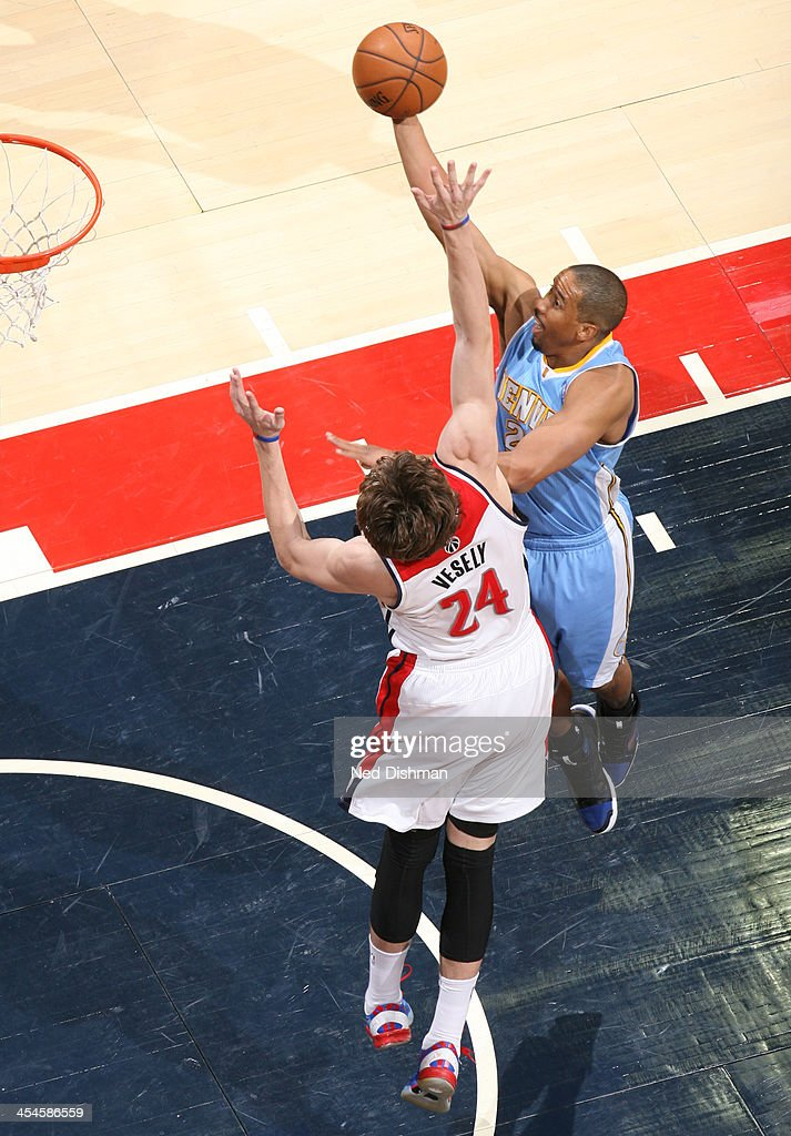 <a gi-track='captionPersonalityLinkClicked' href=/galleries/search?phrase=Andre+Miller&family=editorial&specificpeople=201678 ng-click='$event.stopPropagation()'>Andre Miller</a> #24 of the Denver Nuggets shoots against <a gi-track='captionPersonalityLinkClicked' href=/galleries/search?phrase=Jan+Vesely&family=editorial&specificpeople=5620499 ng-click='$event.stopPropagation()'>Jan Vesely</a> #24 of the Washington Wizards during the game at the Verizon Center on December 8, 2013 in Washington, DC.