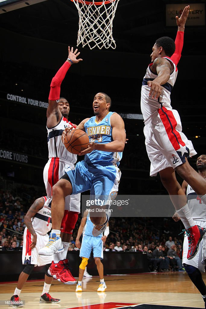 <a gi-track='captionPersonalityLinkClicked' href=/galleries/search?phrase=Andre+Miller&family=editorial&specificpeople=201678 ng-click='$event.stopPropagation()'>Andre Miller</a> #24 of the Denver Nuggets shoots against <a gi-track='captionPersonalityLinkClicked' href=/galleries/search?phrase=John+Wall&family=editorial&specificpeople=2265812 ng-click='$event.stopPropagation()'>John Wall</a> #2 and <a gi-track='captionPersonalityLinkClicked' href=/galleries/search?phrase=Bradley+Beal&family=editorial&specificpeople=7640439 ng-click='$event.stopPropagation()'>Bradley Beal</a> #3 of the Washington Wizards during the game at the Verizon Center on February 22, 2013 in Washington, DC.