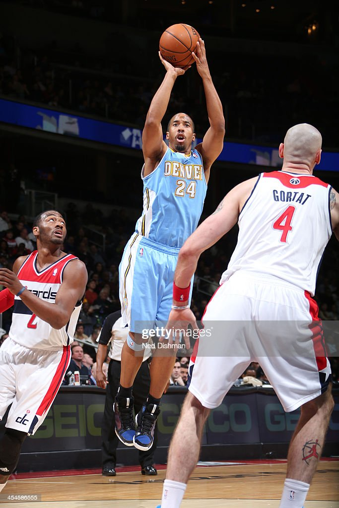 <a gi-track='captionPersonalityLinkClicked' href=/galleries/search?phrase=Andre+Miller&family=editorial&specificpeople=201678 ng-click='$event.stopPropagation()'>Andre Miller</a> #24 of the Denver Nuggets shoots against <a gi-track='captionPersonalityLinkClicked' href=/galleries/search?phrase=John+Wall&family=editorial&specificpeople=2265812 ng-click='$event.stopPropagation()'>John Wall</a> #2 and <a gi-track='captionPersonalityLinkClicked' href=/galleries/search?phrase=Marcin+Gortat&family=editorial&specificpeople=589986 ng-click='$event.stopPropagation()'>Marcin Gortat</a> #4 of the Washington Wizards during the game at the Verizon Center on December 8, 2013 in Washington, DC.