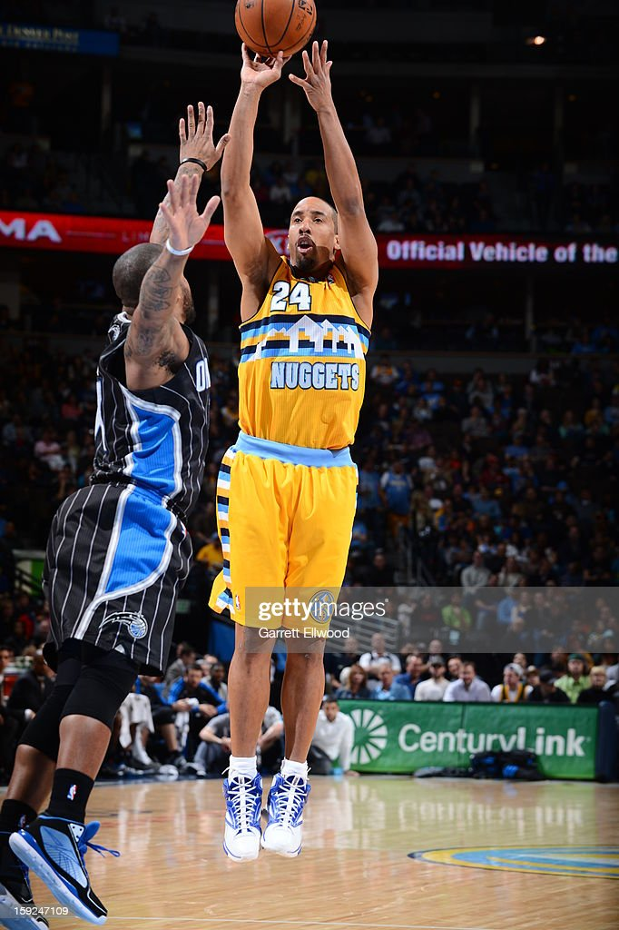 <a gi-track='captionPersonalityLinkClicked' href=/galleries/search?phrase=Andre+Miller&family=editorial&specificpeople=201678 ng-click='$event.stopPropagation()'>Andre Miller</a> #24 of the Denver Nuggets shoots against the Orlando Magic on January 9, 2013 at the Pepsi Center in Denver, Colorado.