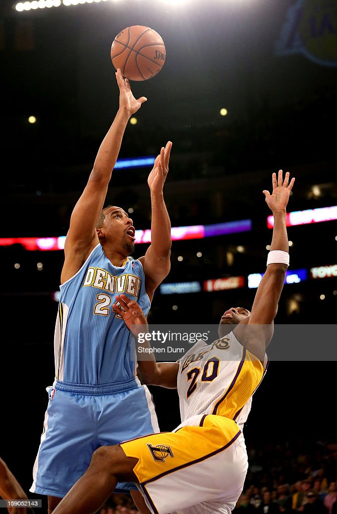 Andre Miller #24 of the Denver Nuggets shoots over Jodie Meeks #20 of the Los Angeles Lakers at Staples Center on January 6, 2013 in Los Angeles, California. The Nuggets won 112-105.