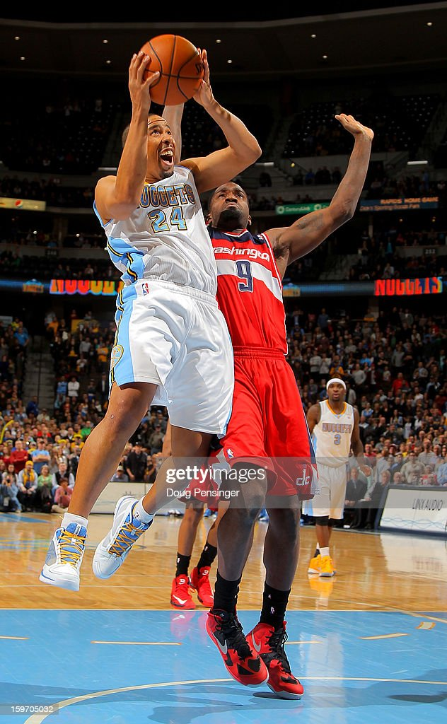 Andre Miller #24 of the Denver Nuggets takes a shot against Martell Webster #9 of the Washington Wizards at the Pepsi Center on January 18, 2013 in Denver, Colorado. The Wizards defeated the Nuggets 112-108.