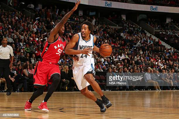 Andre Miller of the Minnesota Timberwolves drives to the basket against Delon Wright of the Toronto Raptors at Canadian Tire Centre on October 14...