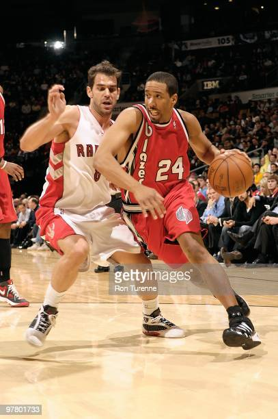 Andre Miller of the Portland Trail Blazers drives against Jose Calderon of the Toronto Raptors during the game on February 24 2010 at Air Canada...