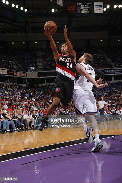 Andre Miller of the Portland Trail Blazers gets to the basket against Andres Nocioni of the Sacramento Kings during a preseason game on October 7...