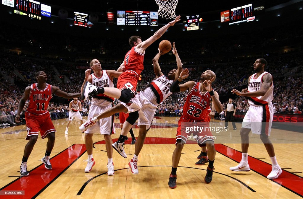 <a gi-track='captionPersonalityLinkClicked' href=/galleries/search?phrase=Andre+Miller&family=editorial&specificpeople=201678 ng-click='$event.stopPropagation()'>Andre Miller</a> #24 of the Portland Trail Blazers shoots the ball against Omar Asik #3 and <a gi-track='captionPersonalityLinkClicked' href=/galleries/search?phrase=Taj+Gibson&family=editorial&specificpeople=4029461 ng-click='$event.stopPropagation()'>Taj Gibson</a> #22 the Chicago Bulls on February 7, 2011 at the Rose Garden in Portland, Oregon.