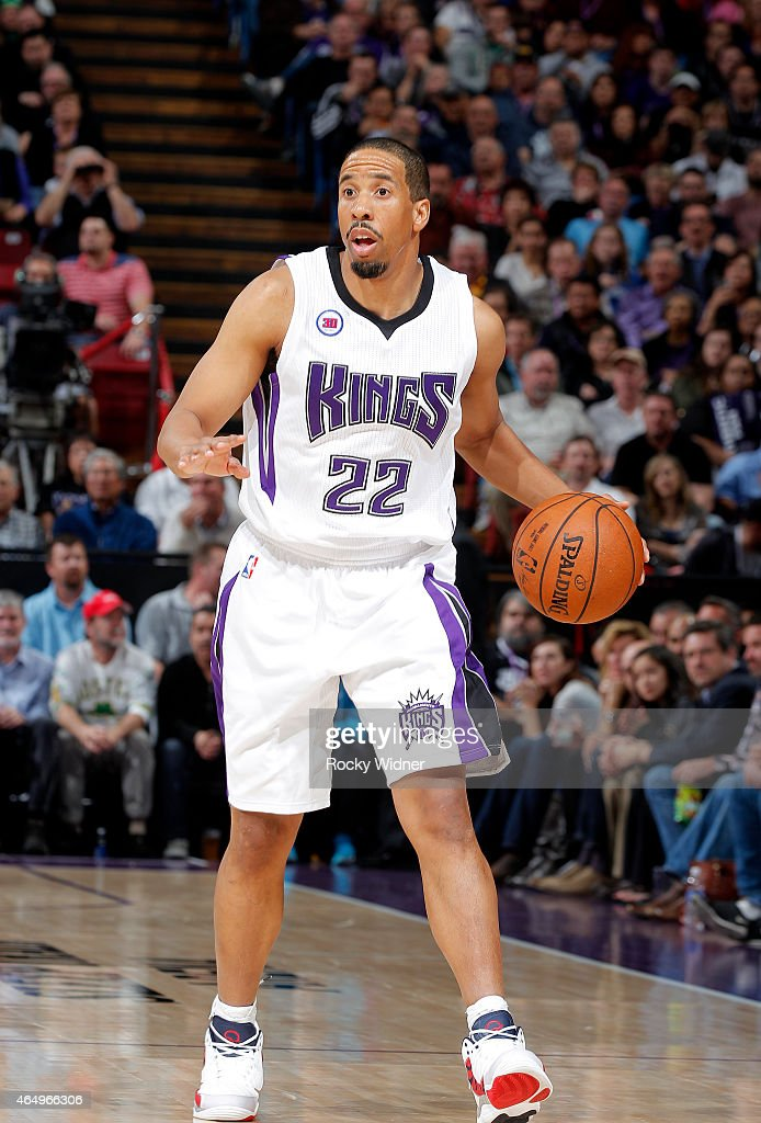 Andre Miller #22 of the Sacramento Kings brings the ball up the court ...