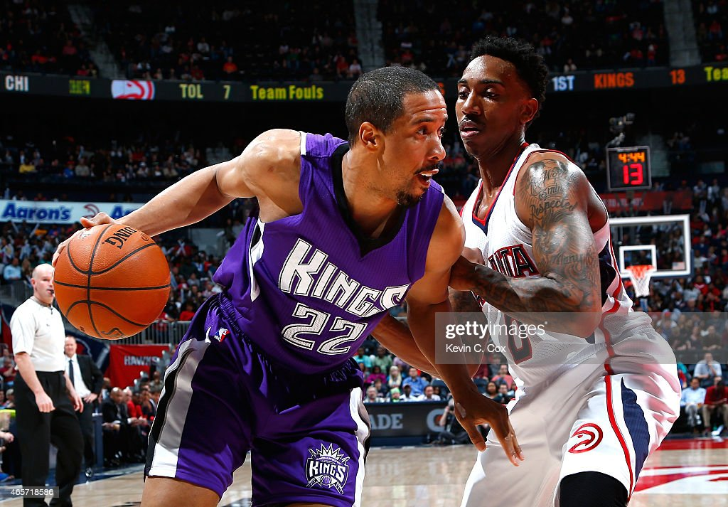 <a gi-track='captionPersonalityLinkClicked' href=/galleries/search?phrase=Andre+Miller&family=editorial&specificpeople=201678 ng-click='$event.stopPropagation()'>Andre Miller</a> #22 of the Sacramento Kings drives against <a gi-track='captionPersonalityLinkClicked' href=/galleries/search?phrase=Jeff+Teague&family=editorial&specificpeople=4680498 ng-click='$event.stopPropagation()'>Jeff Teague</a> #0 of the Atlanta Hawks at Philips Arena on March 9, 2015 in Atlanta, Georgia.