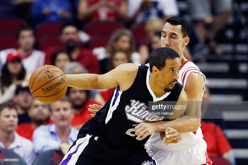 <a gi-track='captionPersonalityLinkClicked' href=/galleries/search?phrase=Andre+Miller&family=editorial&specificpeople=201678 ng-click='$event.stopPropagation()'>Andre Miller</a> #22 of the Sacramento Kings drives with the basketball as <a gi-track='captionPersonalityLinkClicked' href=/galleries/search?phrase=Pablo+Prigioni&family=editorial&specificpeople=664673 ng-click='$event.stopPropagation()'>Pablo Prigioni</a> #9 of the Houston Rockets defends during their game at the Toyota Center on April 1, 2015 in Houston, Texas.